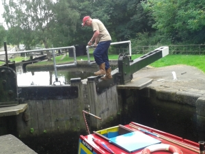 man operating a canal lock
