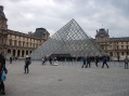 The famous glass pyramid entrance to the Louvre.